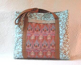 Aqua blue and cinnamon red knitting bag with art nouveau fabric side pockets