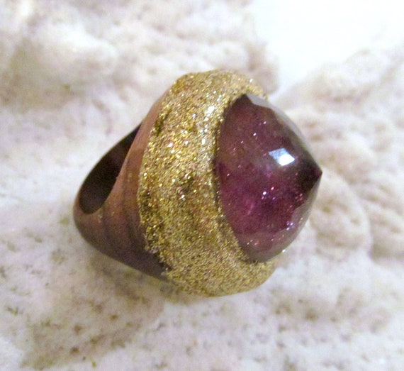 SALE Faceted Amethyst set in gold atop a carved wooden ring