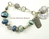 Silver Bracelet of Turquoise and Black Lampwork Beads