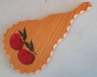 Decorative Wooden Cutting Board In A Pear Shape.