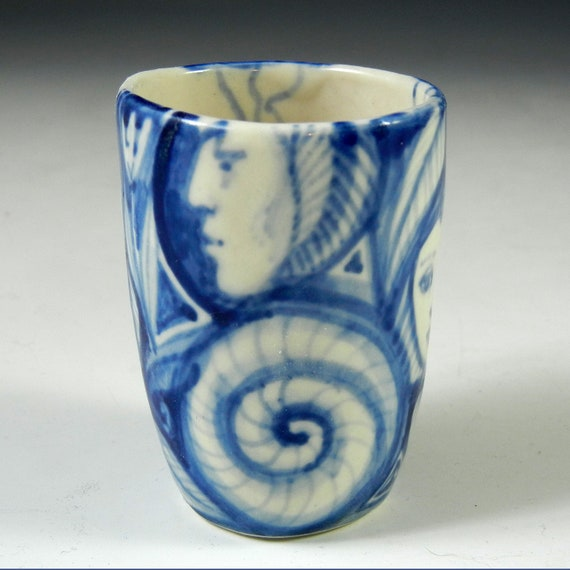 reserve for jennibram Little blue and white porcelain painted shot glass with faces