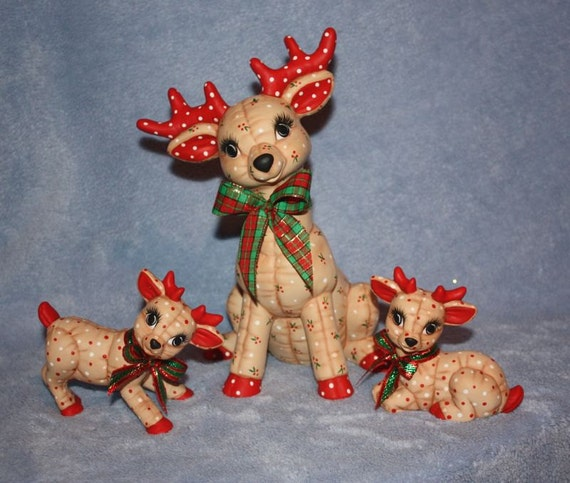 Handpainted Ceramic Christmas Reindeer Set painted with a Holly Berry print Set includes the sitting Mama deer and two baby deer