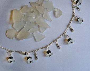 Sea glass bracelet with black crystals. Beach glass jewelry.