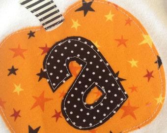 Halloween pumpkin initial one piece