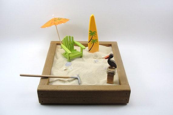 miniature zen beach garden, natural cedar box, green adirondack chair, umbrella, pelican on piling, sea shells, surfboard