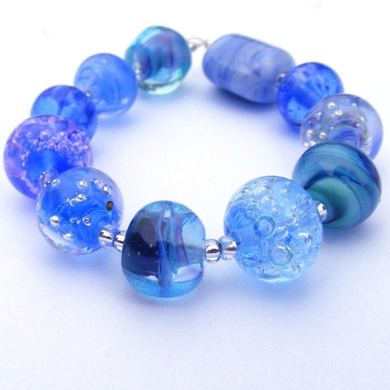 Handmade lampwork glass bead set of 11 renegade beads - blue orphans