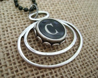 Typewriter key necklace, letter C on black key, silver toned geometric oval pendant, with black bead chain