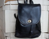 Small black leather COACH backpack