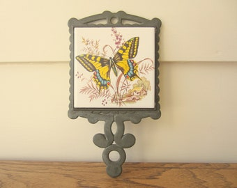 Wow.  Beautiful vintage butterfly trivet.  Anthropologie style desk organization.