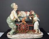 Vintage Pucci The Organ Grinder Music Box  Bisque Figurine