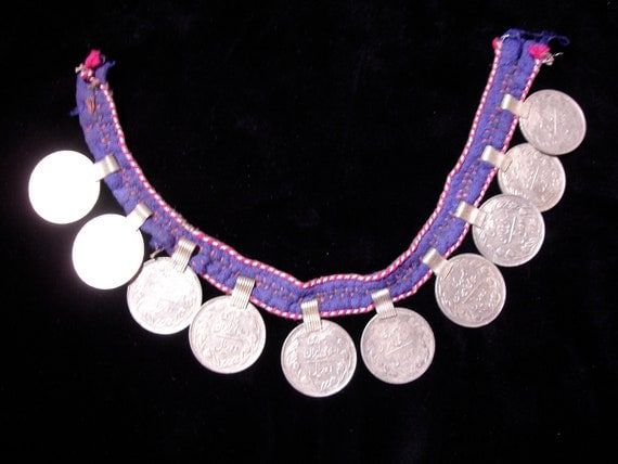 Purple string of coins