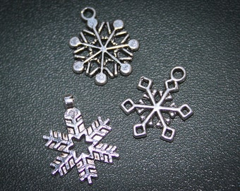 75% off 12 silver Snowflake winter charms for alrered art, jewelry making , bracelets  Christmas lead and nickel free DIY
