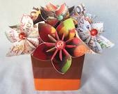 Thanksgiving paper flower arrangement in ceramic vase, brown and orange