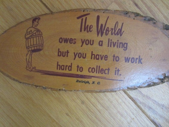 The World owes you a living but you have to work to collect it. Raleigh NC Souvenir Vintage 1960s Wooden Plaque Kitschy Naked Man in Barrel