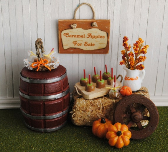 """Miniature Fall Scene With Bale Of Hay, A Barrel, Caramel Apples, Pumpkins, A Fall Flower Arrangement, And A """"Caramel Apples For Sale"""" Sign"""