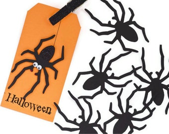 Black spider paper die cuts. DIY Black widow Halloween Gift Tag set paper cuts. 20 Spooky trick or treat gift embellishments.