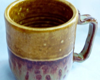 Handthrown coffee cup two toned yellow gold and yellow gold and brick tone