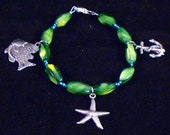 NAUTICAL CHARM BRACELET - glass beaded bracelet w/ starfish, fish, and anchor charms