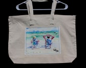 A couple lounging on the beach zippered tote bag