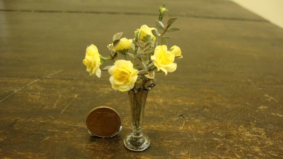 Miniature jug with  yellow roses