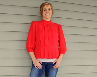 1970s red pleated blouse. Loose and lightweight. Size medium 8-10