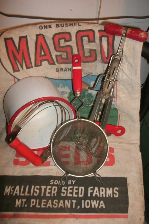 Vintage Red Kitchen Utensils, red wood and a feed sack