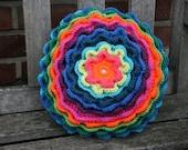 Blooming flower pillow in rainbow colors (orange - pink - green - blue - purple)