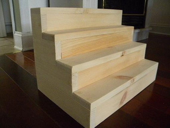 Step display shelf . Display your treasures on rows of steps