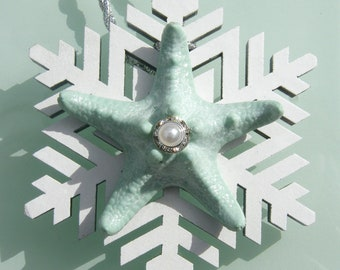 Snowflake Ornament with coastal mint blue knobby starfish and rhinestone and pearl accent.