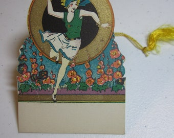 Art Deco 1920's die cut bridge tally place card blonde flapper playing tennis gold gilded colorful flowers unused Rust Craft