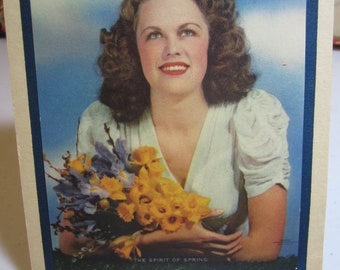 Vintage 1940's pin up photo model pretty girl holding bouquet of spring flowers Seasons greeting card and calender