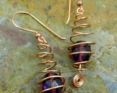 Copper caged purple fire polished earrings