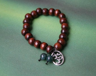 Yogi inspired dark wood bead mala meditation bracelet with Om charm and green jade gemstones