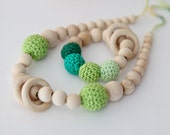 Set of 2. Green nursing rings necklace and shade of green teething ring toy.