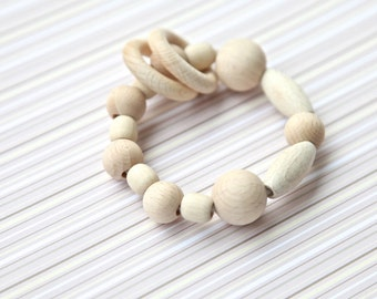 Natural wooden toy. Neutral waldorf wooden beads rattle.