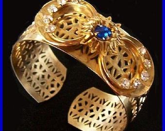 "Blue Rhinestone Cuff  Bracelet Gold Metal Filigree Ribbon Design 1"" W Big Chunky Vintage"