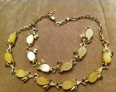 Yellow cabochon and gold-tone jewelry set