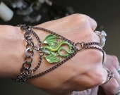 """Gothic Renaissance Dragon """"Slave Bracelet"""" Ring. Green Dragon with yellow belly. Adjustable. Fits sizes 6"""" on up around the wrist."""