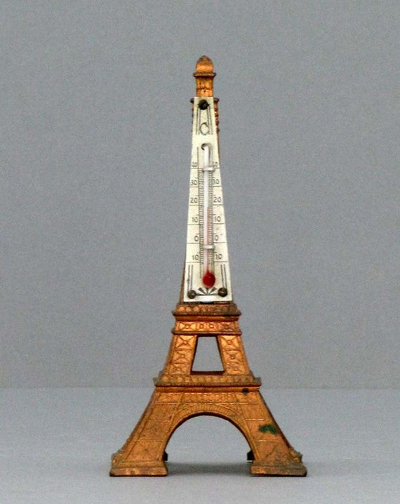 A french eiffel tower thermometer