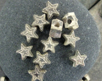 Tiny 5mm Etched Star Beads in Silver.  3 dz.