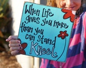 when life gives you more than you can stand kneel  wood sign card