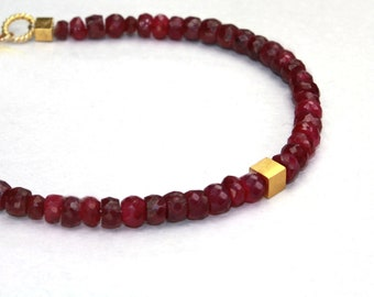 Tweedle 2. Gold Vermeil and Ruby Beaded Bracelet or Anklet. Red Friendship Bracelet with a Gold Vermeil Disk Charm.