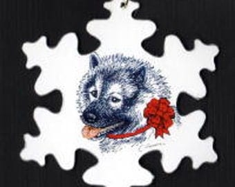 Keeshond with red bow Christmas ornament