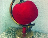 red velvet globe pincushion with built-in measuring tape