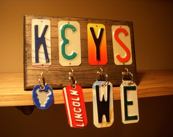 Key rack made from recycled license plates.