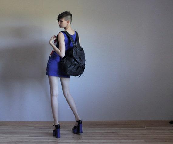 Oversized black leather backpack