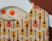Mod Organic Linen Guitar Print Baby Bib