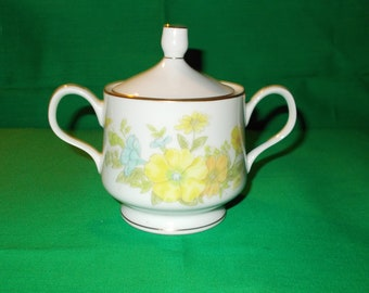 One (1), Sugar Bowl with Lid,  from EKCO International, in the Spring Bouquet Pattern.