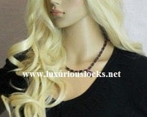 Carolina // Blonde Curly Synthetic Wig