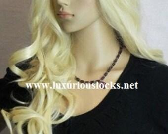 Carolina // Blonde Curly Synthetic Wig